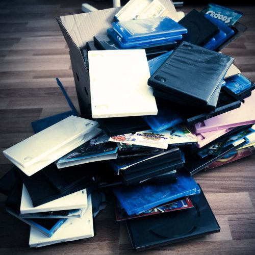 A pile of DVD covers on the floor