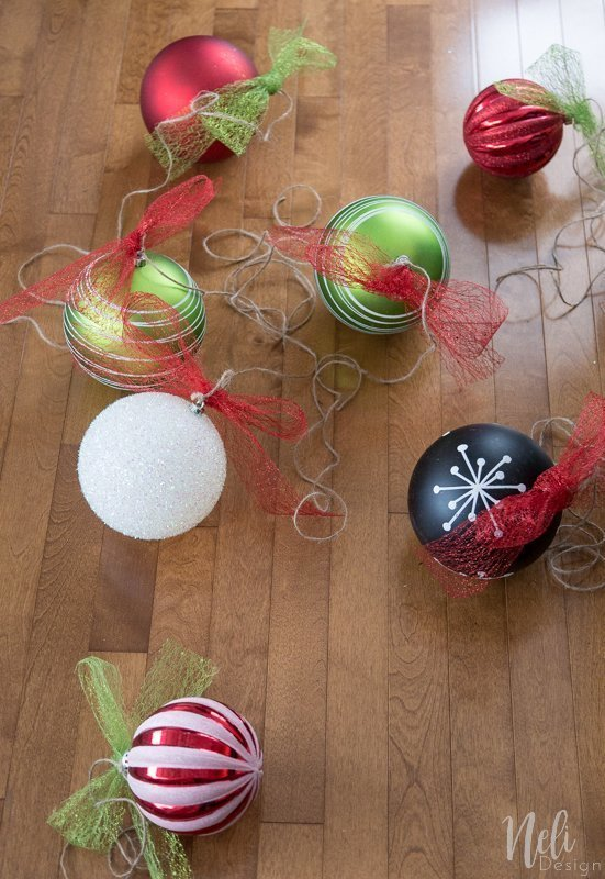 Adding ribbons and jute twine when you Hang Christmas ornaments