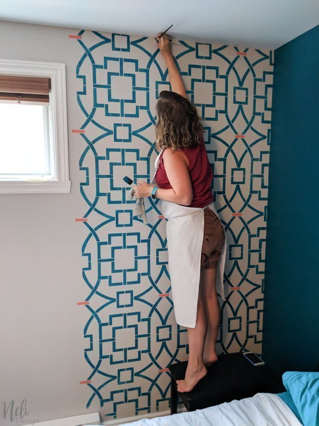 Stencilling a wall with a stencil from Cutting Edge Stencil. This geometric pattern will look great for an accent wall in my master bedroom. I even used 2 colors for the Tea House Trellis Allover Stencil. You can find out if stencilling is for you or not! Stencil will bleed and it won't be perfect. See why. #cuttingedge #stencil #diy #masterbedroom #makeover