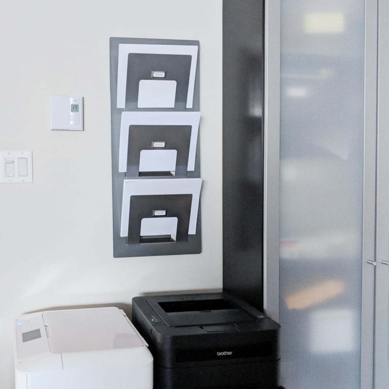 Simple Printer paper storage to help you keep your sanity. This idea will organize your printer area and desk. This simple magazine holder is a great solution. It also comes with a free printable for the labels #deskorganization #printables # freebie #paperstorage