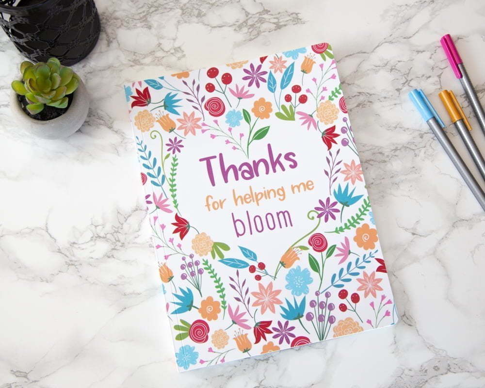 "Note book written ""Thanks for helping me bloom"""