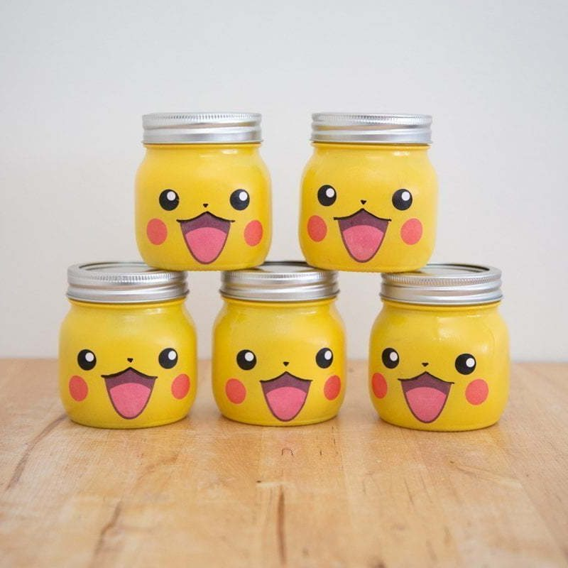The final result of the DIY Pikachu Mason Jar gifts. 5 jars mounted in a pyramid (3 at the bottom and 2 on top)