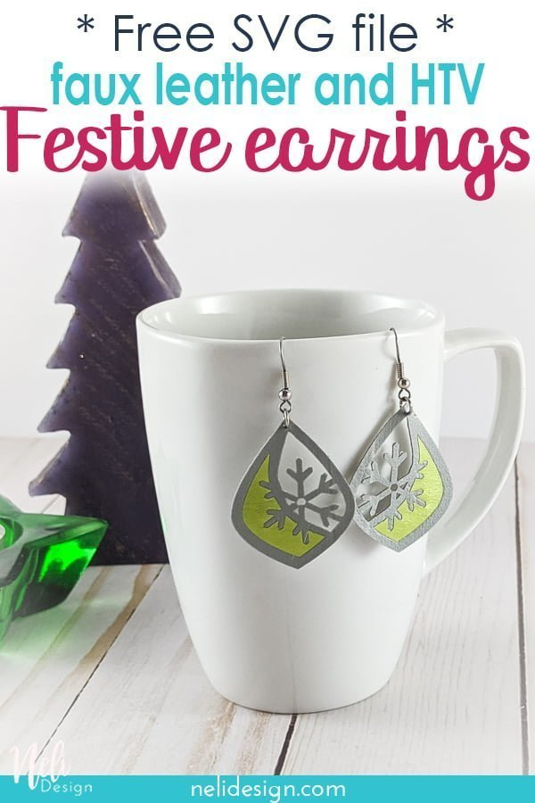 faux leather and green vinyl earrings hung on a mug with a fir tree and a star candle written free SVG file DIY festive earrings in Faux leather and HTV.