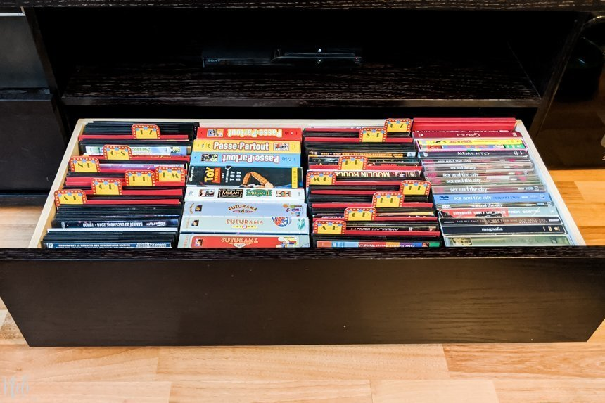 A view of the drawers where the DVDs are organized using the tab dividers for better organization