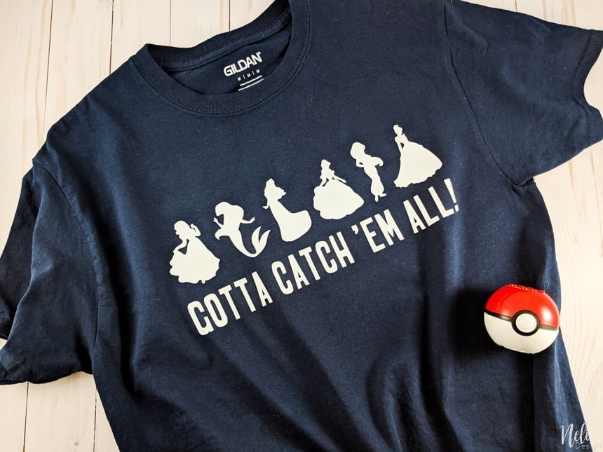 T-shirt with Iron-on vinyl of Pokemon. Disney princess silhouettes written underneath : Gotta catch 'em all