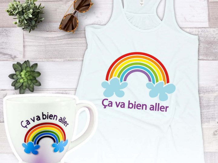 Tank top and mug, both with rainbows that were made to show how to layer vinyl with your Cricut
