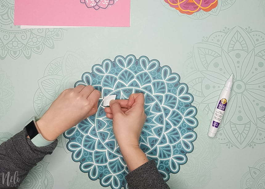Adding glue to the 3D layered mandalas made with the free SVG files