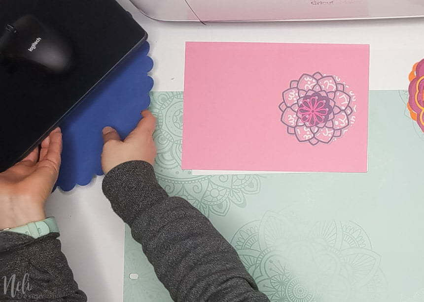 Putting the mandala under laptop to make the 3D layered mandalas made with the free SVG files