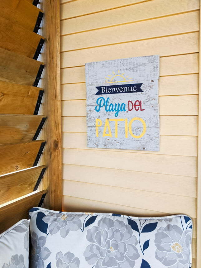 Painted Wood sign made with a Cricut Stencil hung on a wall saying Welcome Playa del patio