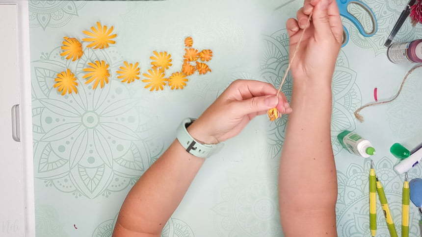Pulling gently on the petals to make the DIY paper Chrysanthemum