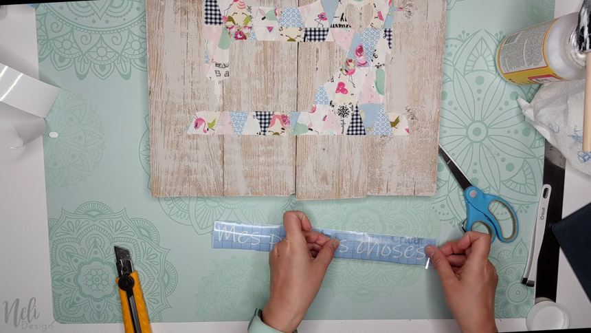 Use a stencil in the Cricut to make the frame text with the fabric scraps.