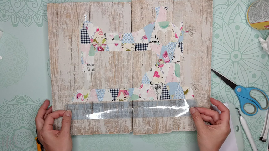 Apply the stencil with the transfer paper on the frame with fabric scraps.
