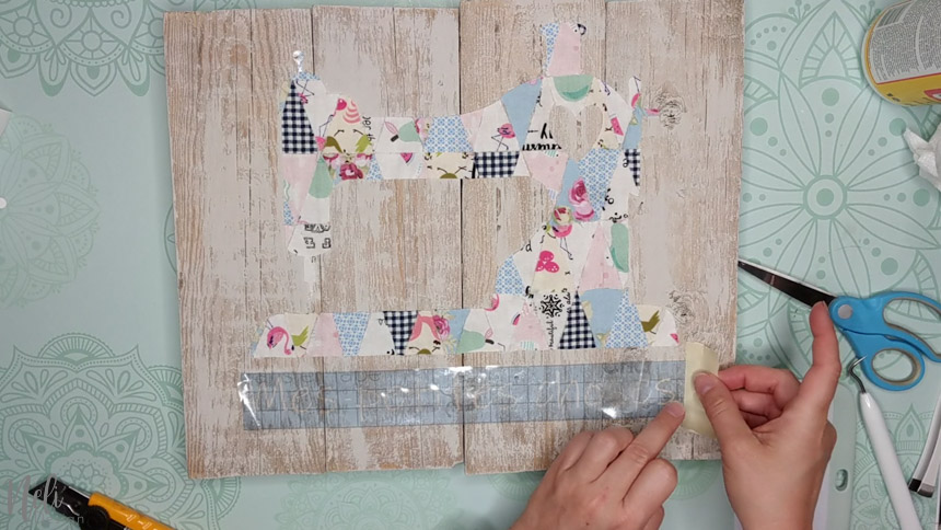 Gently remove the paper transfer from the frame with the fabric scraps