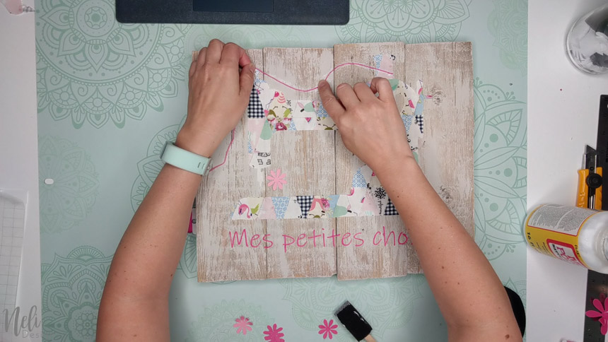 Glue the embroidery thread with Mod Podge to make the frame with the fabric scraps and your Cricut.
