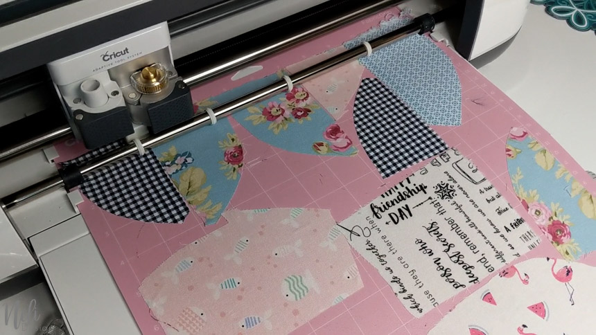 Place the fabric scraps on the mat to make a frame with your Cricut.