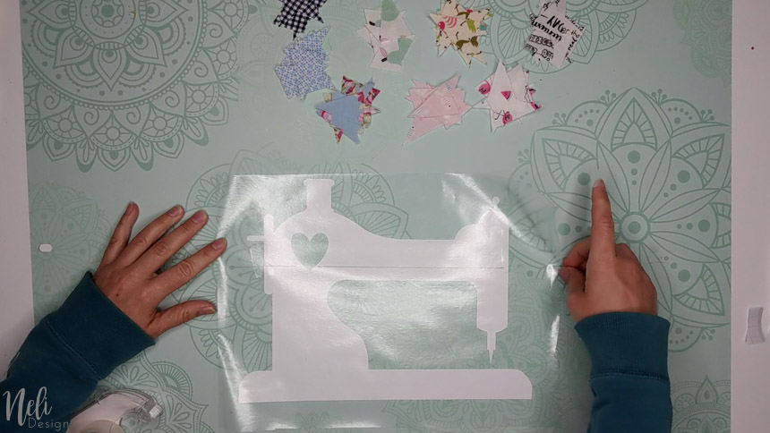 Place the transfer sheet to make a frame with fabric scraps in Cricut Design Space.