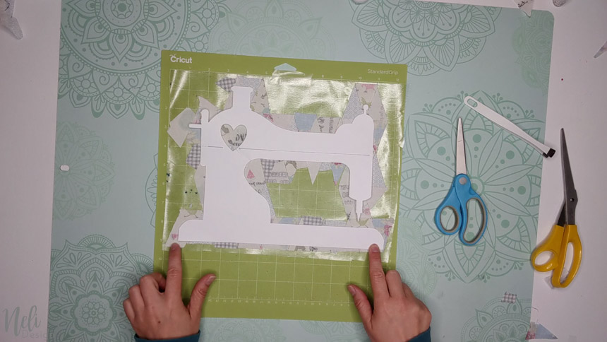 Transfer to the Cricut mat to make a frame with fabric scraps.