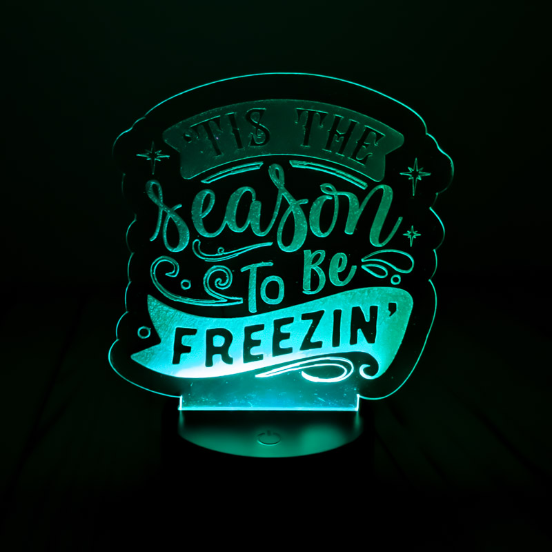 An engraved led night light written it's the season to be freezing