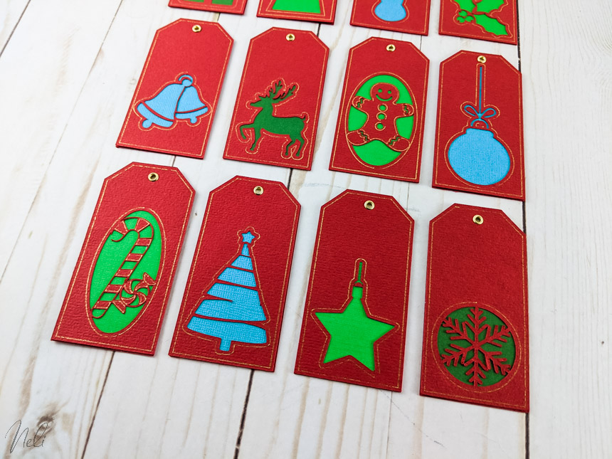 12 Christmas tags made with Cricut Foil tip