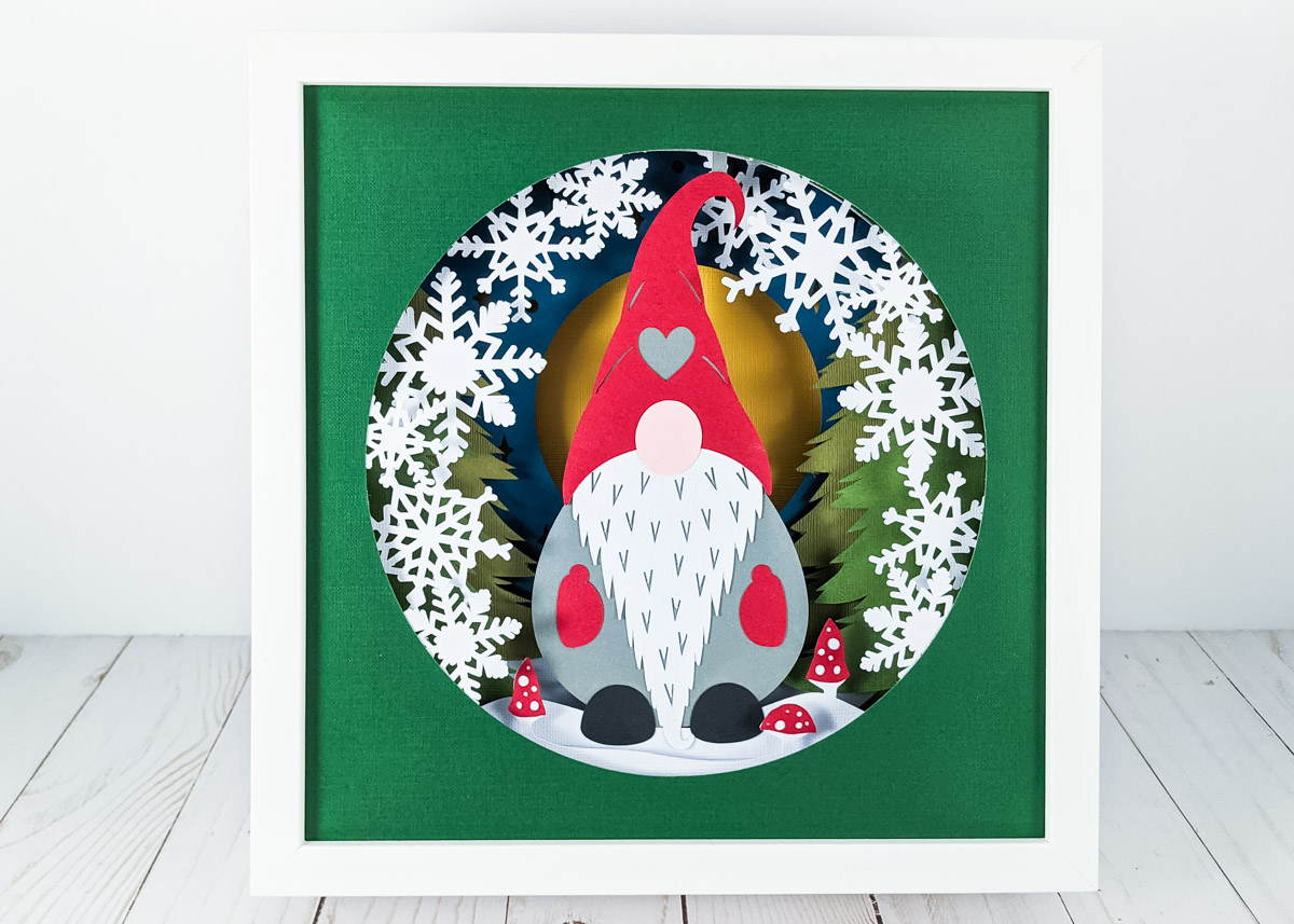 3D shadow box of a Christmas gnome with snowflakes